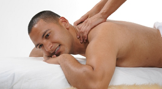 friendlymalemassage- young man receiving shoulder massage